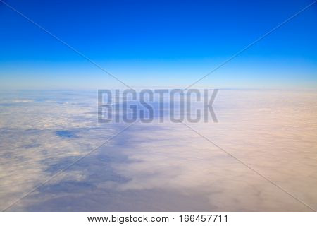 Earth covered with clouds from high sky.