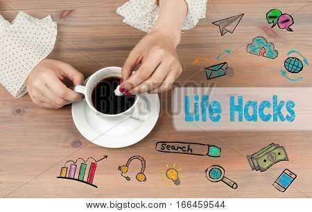 Life Hacks. Coffee cup top view on wooden table background.