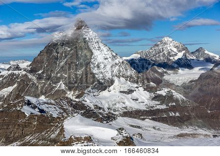 Amazing Panorama of mount Matterhorn covered with clouds, Canton of Valais, Alps, Switzerland