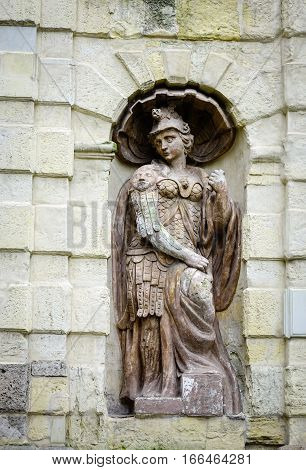 God Statue On The Stone Wall At Ancient Castle