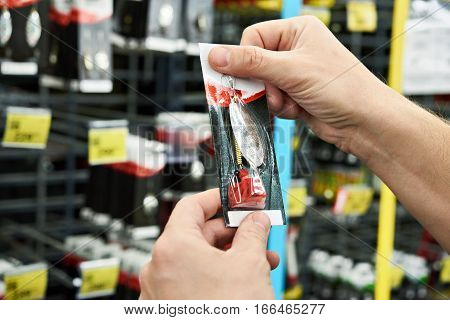 Fishing Lure Bait In Hands Man In Store