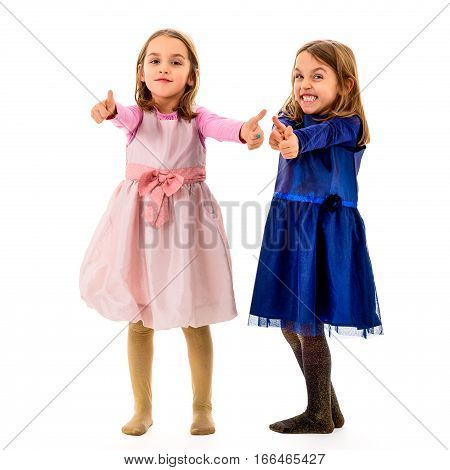 Twin Girls Are Showing Thumbs Up Sign Or Gesture.
