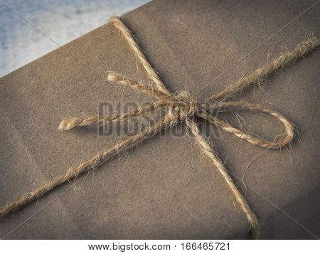 Sending packed in paper and tied with jute rope