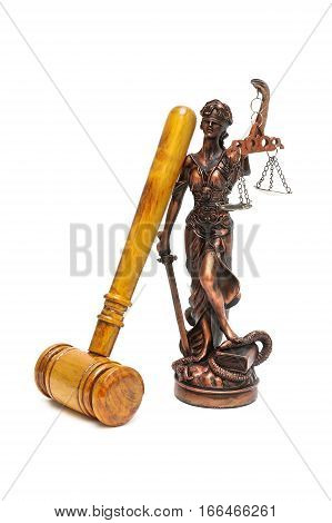 statue of justice and judges gavel on a white background. vertical photo.