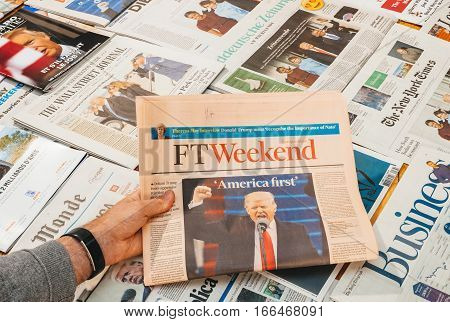 PARIS FRANCE - JAN 21 2017: Major international newspaper journalism Financial Times featuring headlines with Donald Trump America First at inauguration as the 45th President of the United States in Washington D.C