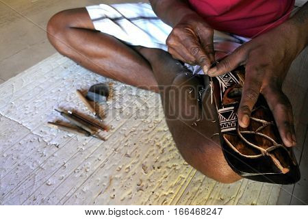 Hands Of Indigenous Fijian Man Wood Carving A Sea Turtle