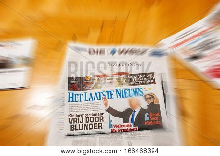 PARIS FRANCE - JAN 21 2017: Het Laatste Niewus major international newspaper journalism featuring headlines with Donald Trump and melania Trump inauguration as the 45th President of the United States in Washington D.C