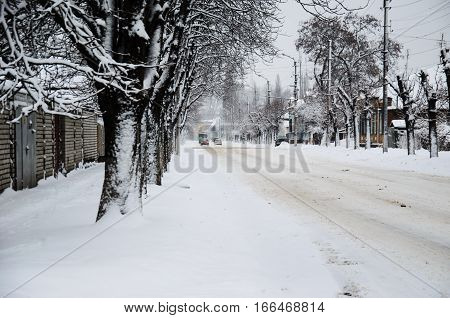 Cars on a road after the snowfall