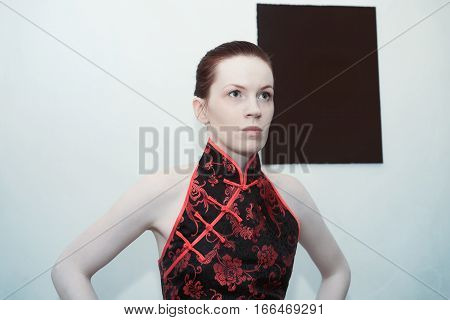 Portrait of a young beautiful redheaded woman