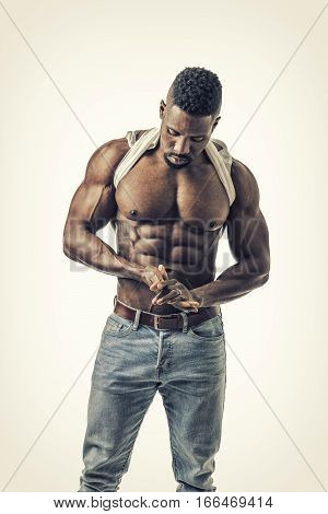Good Looking Black Gym Fit Man Showing His Sexy Six Pack Abs While Looking down. On White Background.