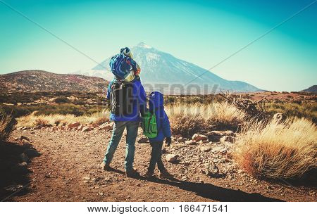 father with two little kids travel in mountains