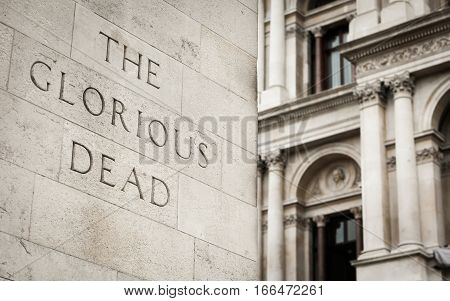 Detail from the Cenotaph on Whitehall London with focus on the phrase 'The Glorious Dead'.