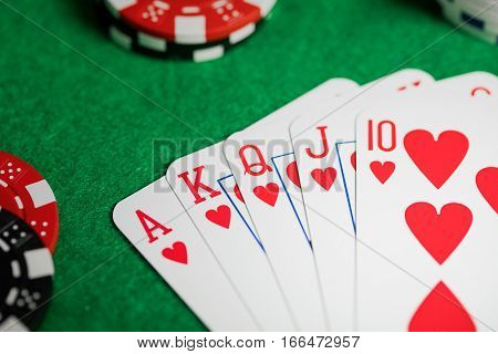 Royal flush in poker game at casino