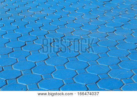 Old blue pavement in a pattern for background
