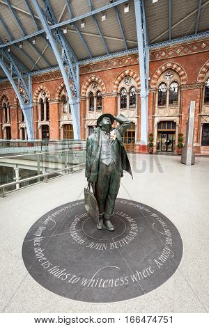 LONDON UK - 24 FEBRUARY 2011: A wide angle portrait of the statue of Sir John Betjement the English poet located in the concourse of St. Pancras train station London.