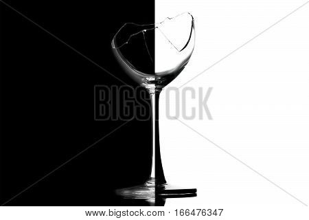 transparent broken wineglass on a black and white background