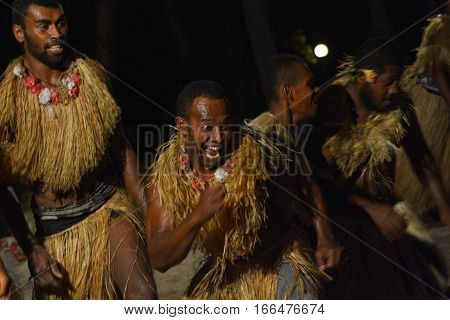 Fijian men dancing a traditional male dance meke wesi the spear dance. Real people copy space