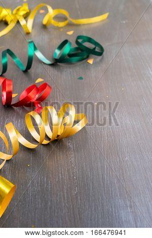 Carnaval festive curling paper on dark wooden background