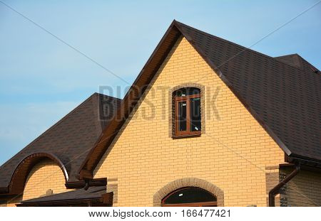 Roofing Construction House Building with Asphalt Shingles and Different Types of Roof Design.