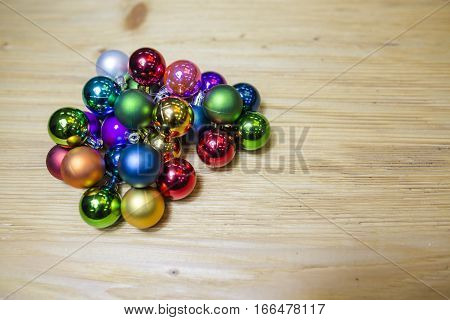 Lie on the table decorations for Christmas trees. Preparing for the New Year.