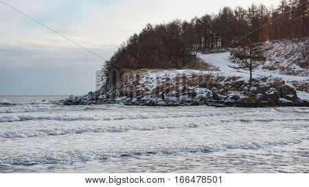 Ice blocks on a black sand beach near Vanino, Russia