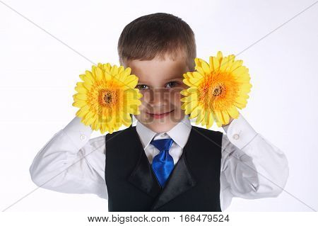 portrait of happy boy with yellow flowers