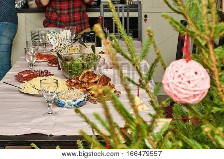 Family setting the festive table to celebrate the New Year holiday.