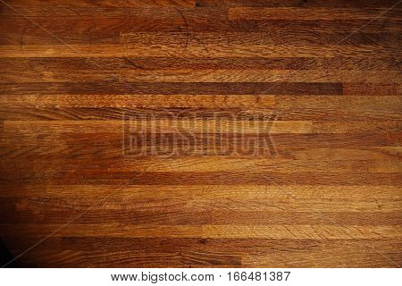 Rich texture of wooden table or floor made of many thin long racks placed horizontally, top view, natural rustic background