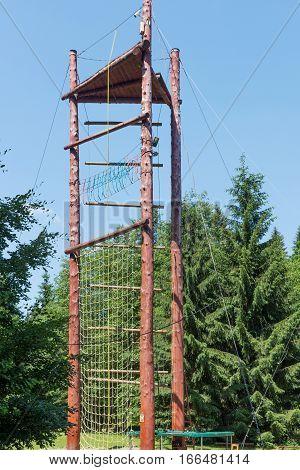 Empty modern children playground in park, wooden playground