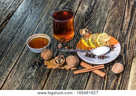 Christmas mulled wine. Mulled wine with spices and lemon slices on a rustic wooden table. Traditional drink on a cold winter day.