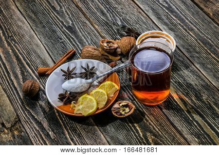 Traditional Scandinavian glogg. A drink with cinnamon and lemon. Dark wood background.
