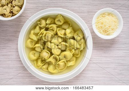 Traditional Italian Tortellini in Brodo (broth) soup photographed overhead with natural light