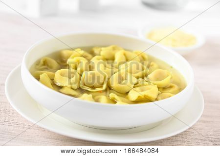 Traditional Italian Tortellini in Brodo (broth) soup photographed with natural light (Selective Focus Focus in the middle of the image)