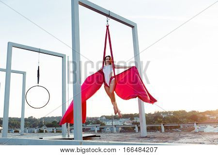 Sexy Dancer Performing Aerial Dance On Roof At Sunset