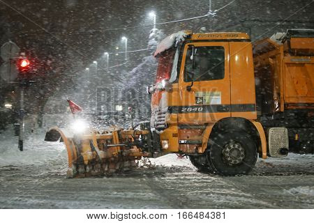 VELIKA GORICA CROATIA - JANUARY 13th 2017 : Snowplow cleaning streets in the aggravated traffic due to strong snowfall in Velika Gorica Croatia.