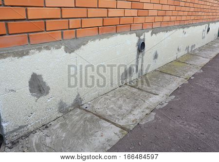Foundation house brick wall insulation with styrofoam for energy saving.