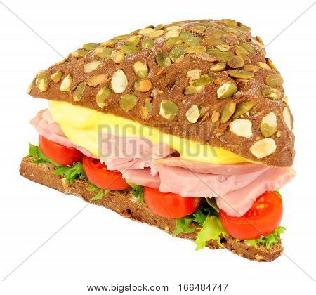 Ham salad sandwich on pumpernickel bread isolated on a white background