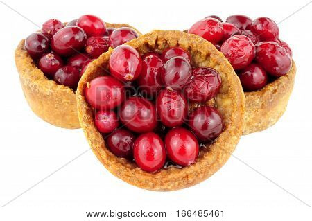 Crusty pork pies topped with cranberries isolated on a white background