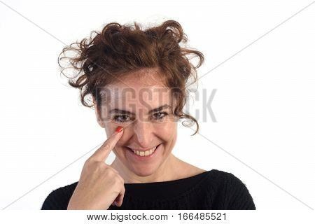 woman with gaze and finger in eye on a white background