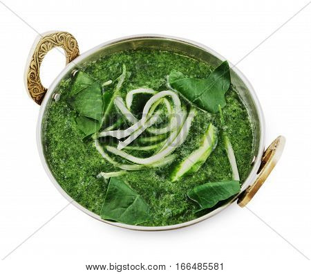 Vegan and vegetarian dish, creamy spinach soup bowl. Indian cuisine, hot meal isolated on white background. Eastern local cuisine restaurant food top view