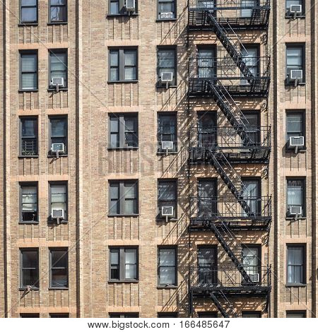 A typical brown brick apartment block found downtown in the Chelsea district of Manhattan New York City.