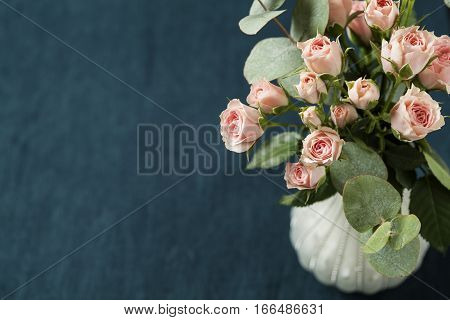 Bouquet of beautiful pink spray roses on dark background