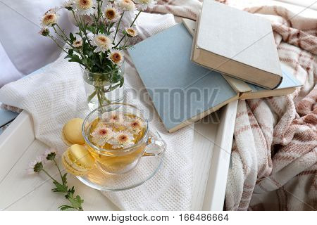 Cup Of Tea And Books In Tray On The Table