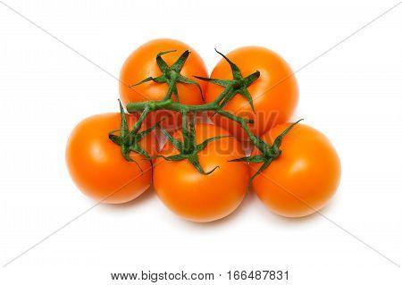 bunch of orange tomatoes on a white background. horizontal photo.