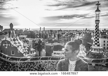Elegant Woman At Guell Park In Barcelona, Spain Looking Aside
