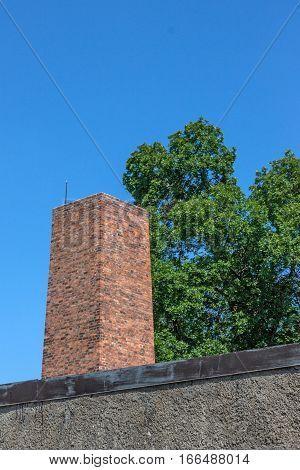 AUSCHWITZ-BIRKENAU CONCENTRATION CAMP, KRAKOW, POLAND - CIRCA JUNE 2012: View of flue pipe of camp crematorium
