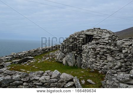 Large stone beehive huts still standing on the Slea Head Penninsula.