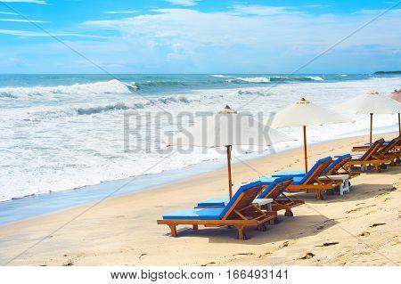Empty deck-chairs on the Bali island beach. Indonesi