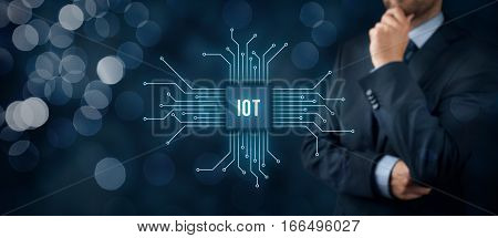 Internet of things (IoT) concept. Businessman think about Internet of Things (IoT). Abstract chip connected with abstract devices represented by points. poster