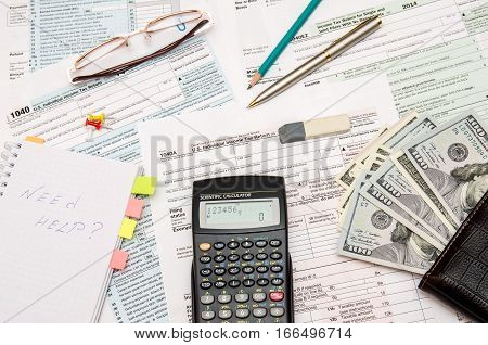 1040 Tax form with money calculator pen glasses